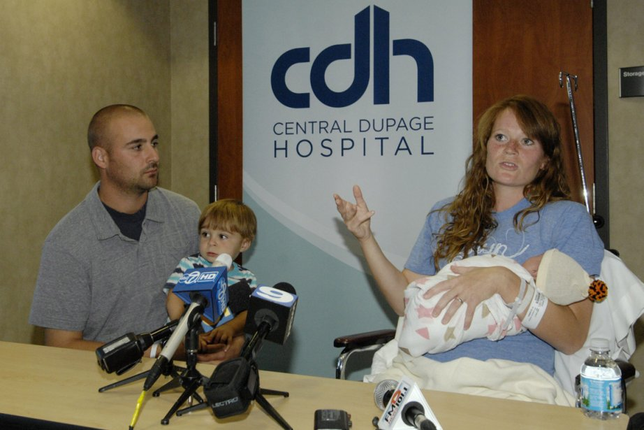Amber Miller, of Westchester, Ill., holds her baby... (Photo: AP)