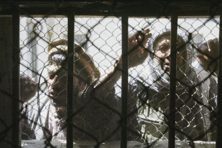 Des prisonniers, en 2003, dans une prison de... (Photo Silvia Izquierdo, AP)