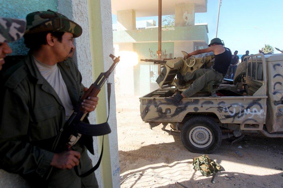 De violents combats à l'arme automatique et aux... (Photo: Ahmed Al-Rubaye, AFP)