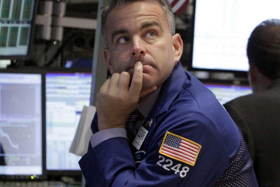 La Bourse de New York évoluait dans le rouge mardi en mi-séance,... (Photo AP)
