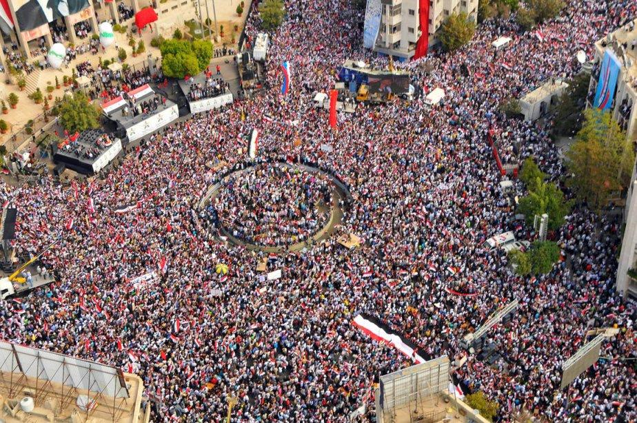 Des miliers de supporteurs du président syrien Syrian... (Photo: Ho-Sana, AFP)