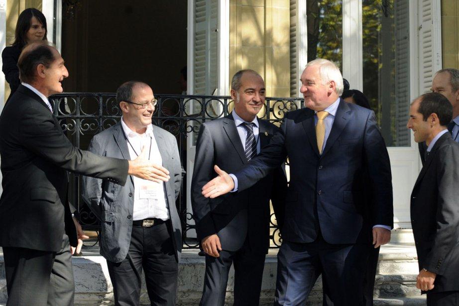 À gauche, l'avocat Sud-africain et membre du groupe... (Photo: Reuters)