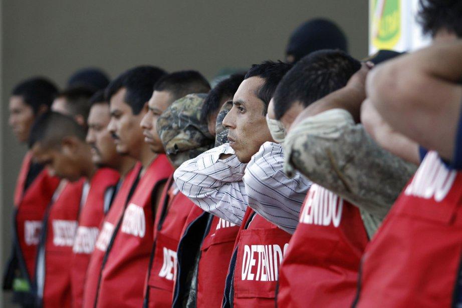 Des membres du groupe criminel de «Los Zetas»... (Photo: Reuters)