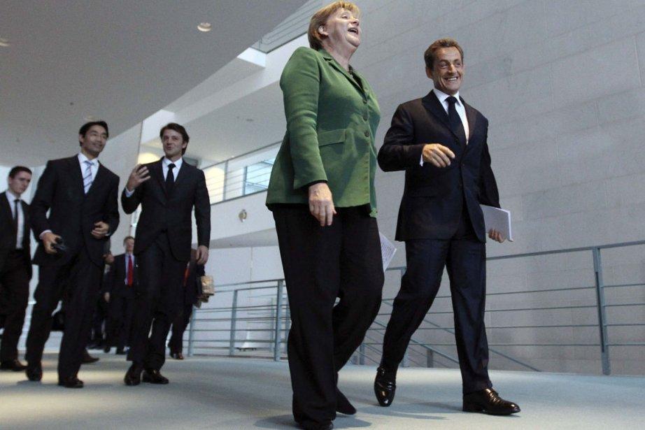Angela Merkel et Nicolas Sarkozy assurent que les... (Photo: Fabrizio Bensch, Reuters)