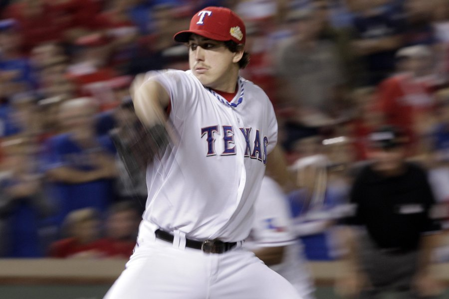 Le lanceur des Rangers Derek Holland n'a accordé... (Photo: AP)