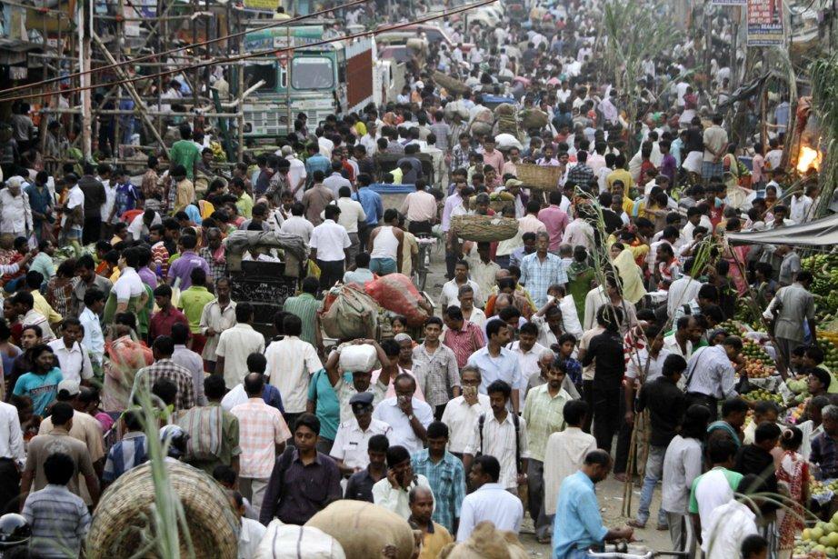 La population mondiale se chiffre aujourd'hui à sept... (Photo: Bikas Das, AP)