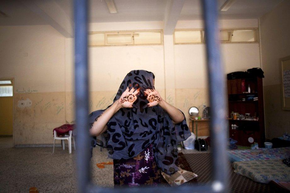 Une femme soupçonné d'être une fidèle de Kadhafi... (Photo: Manu Brabo, Archives Associated Press)