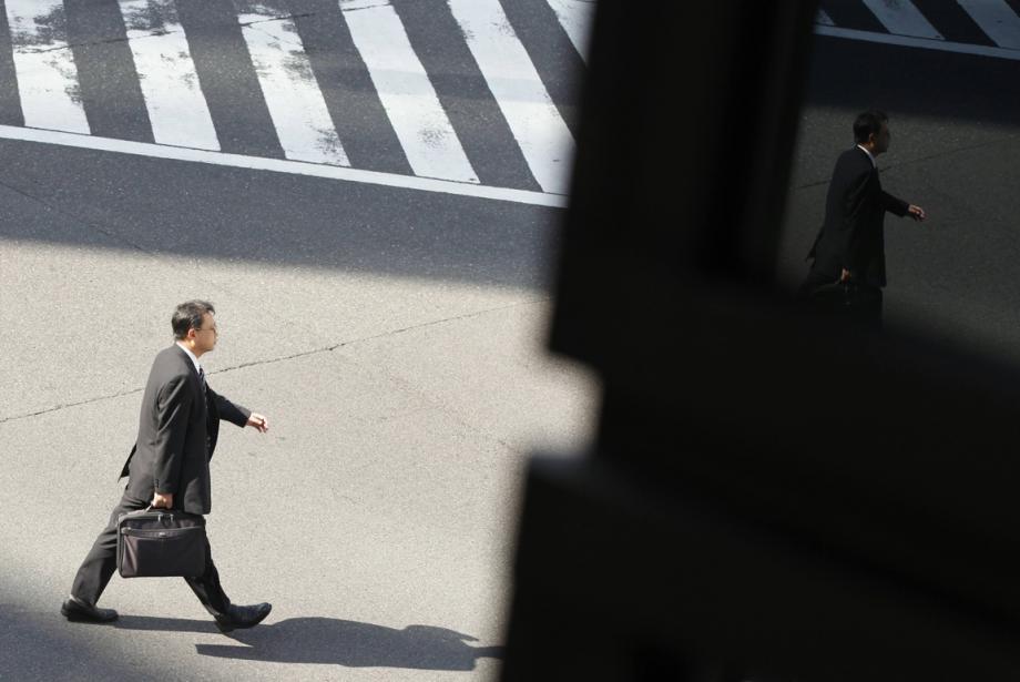 Un avocat qui commence dans une grosse firme... (Photo archives Reuters)