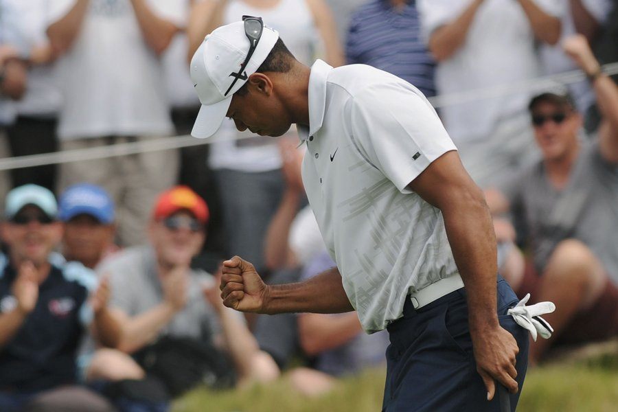 Tiger Woods a joué une ronde de 67... (Photo: AFP)