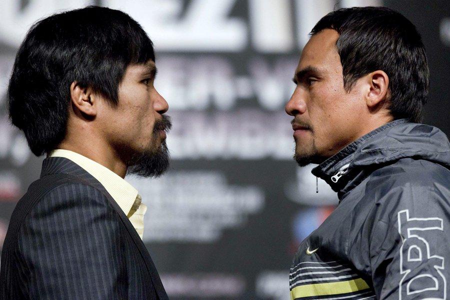 Manny Pacquiao (à gauche) et Juan Manuel Marquez.... (Photo: AP)