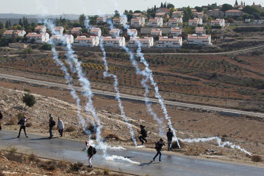 «Israël continue de s'engager dans des activités de... (Photo: Abbas Momani, AFP)