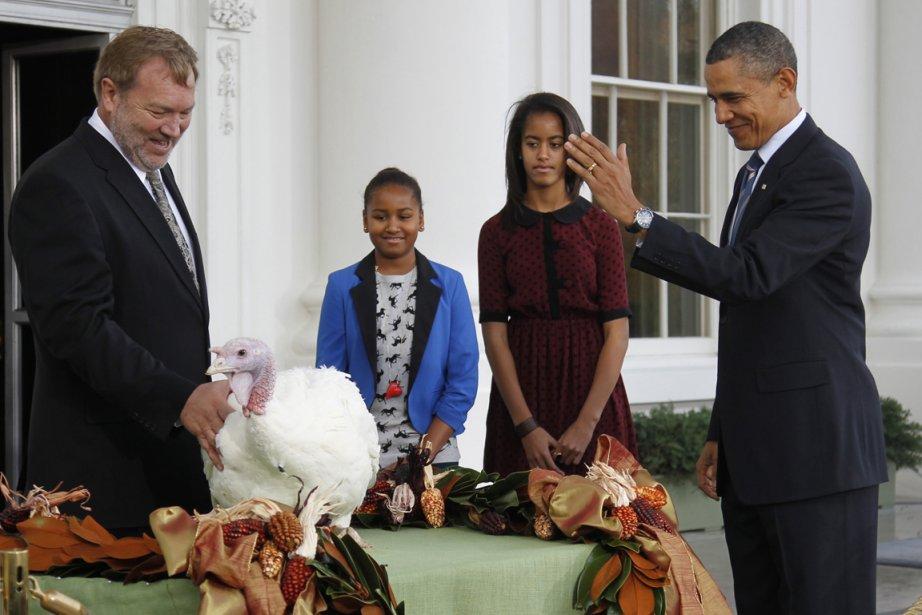Accompagné de ses filles Sasha et Malia, le... (Photo: Jason Reed, Reuters)
