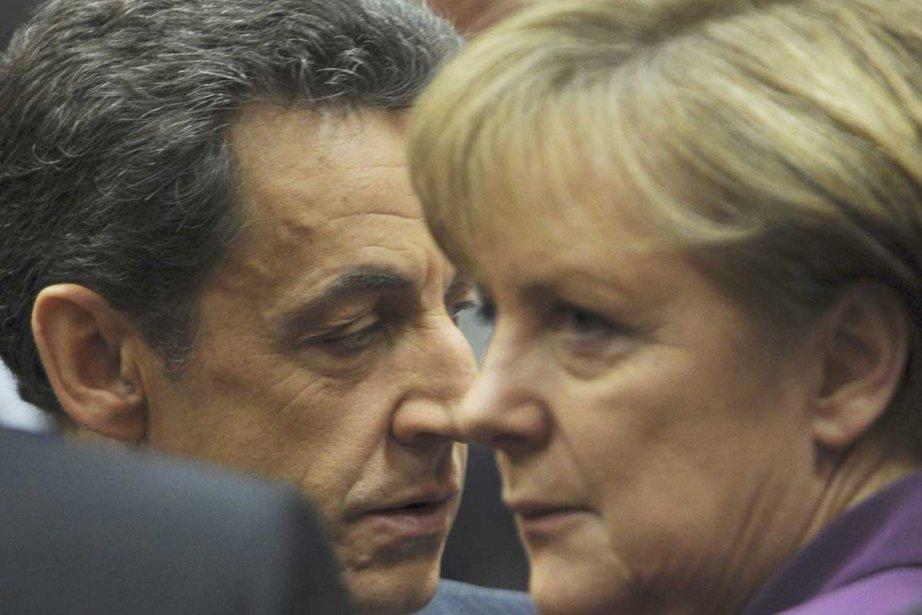 Bien que Mme Merkel ait salué officiellement la... (Photo AFP)