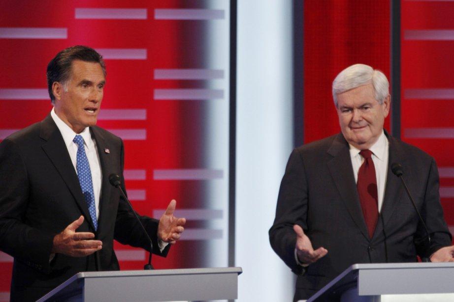 Deux des candidats républicains à l'investiture républicaine, Mitt... (Photo: JEFF HAYNES, Reuters)