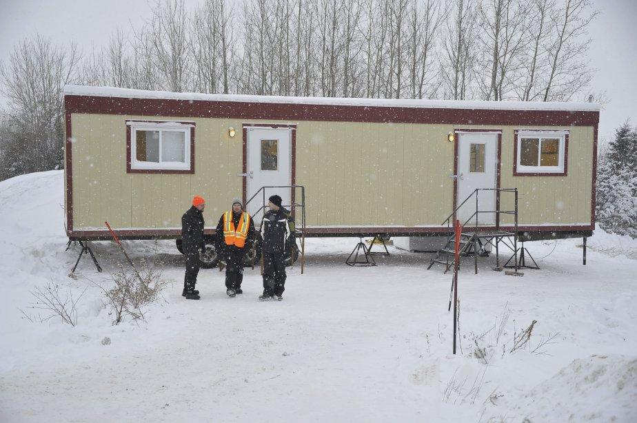 31 DÉCEMBRE Le syndicat a loué une roulotte pour permettre aux travailleurs de se réchauffer. | 1 janvier 2012