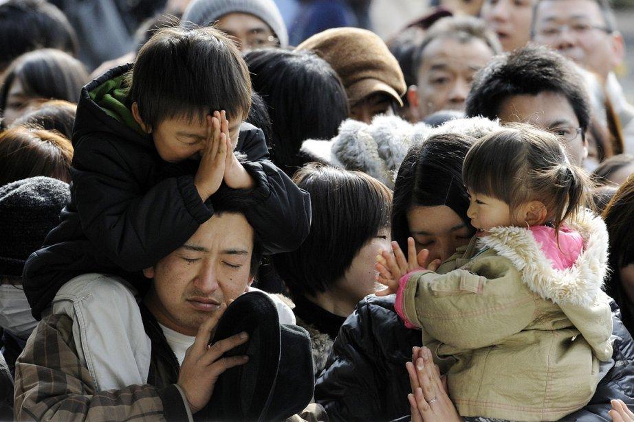 Le séisme du 11 mars suivi d'un tsunami... (Photo: AFP)