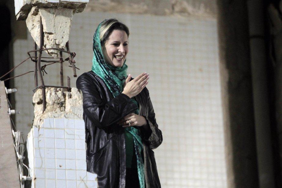 Aïcha Kadhafi chercherait un nouveau pays pour l'accueillir.... (Photo: Joseph Eid, Archives AFP)