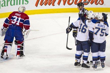 Les joueurs des Blues ont célébré près du... (Photo: Robert Skinner, La Presse)