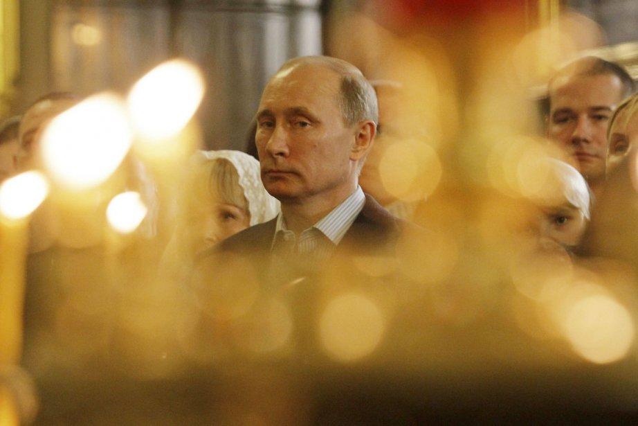 Le premier ministre russe Vladimir Poutine assiste à... (Photo: Dmitry Lovetsky, Reuters)