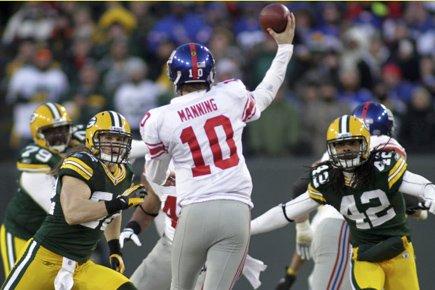 Pour Eli Manning et les Giants de New York, le Lambeau Field... (Photo: Reuters)