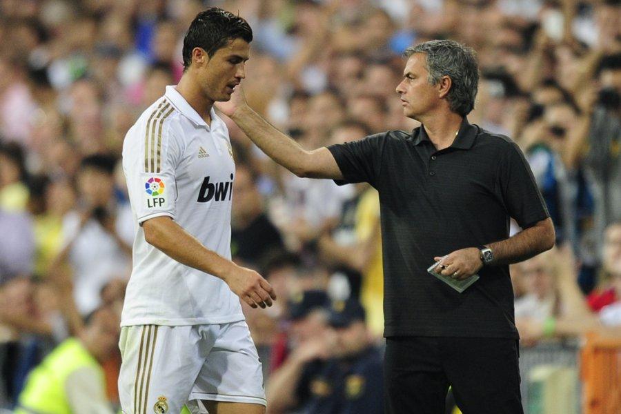 Cristiano Ronaldo et l'entraîneur du Real Madrid, Jose... (Photo: AFP)