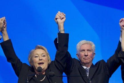 Pauline Marois, qu'on voit ici aux côtés de... (Photo: Reuters)