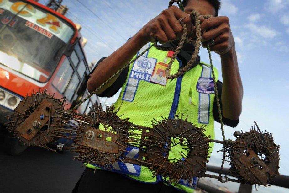 Abdul Rohim, membre dela «Komunitas Sapu Bersih Ranjau... (Photo: Romeo Gacad, AFP)