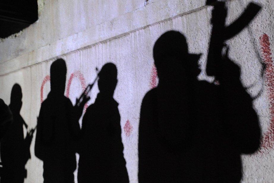 Sa'er affirme qu'il a été forcé à devenir... (Photo: AFP)