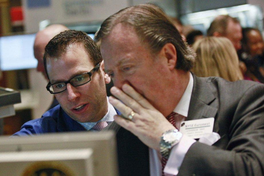 La Bourse de New York évoluait sans direction vendredi, dans... (Photo Reuters)