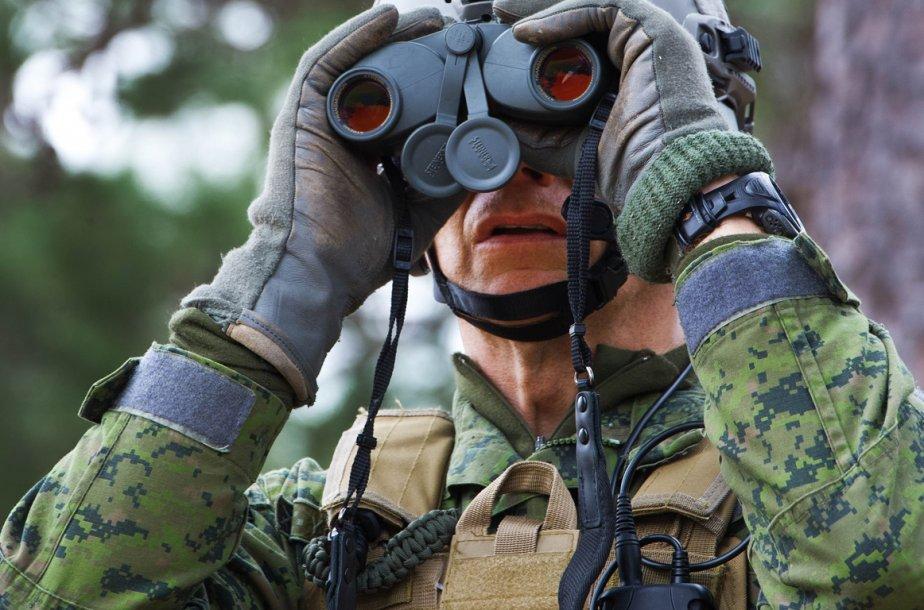 Q «Quel est le salaire annuel moyen d'un soldat canadien? Son... (Photo AFP)