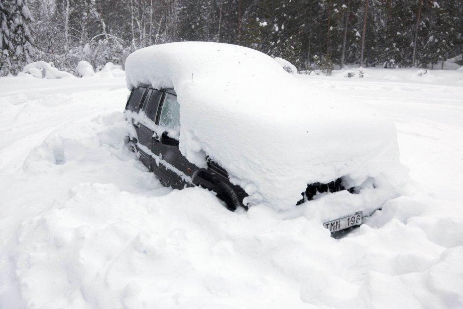 L'épaise couche de neige sur la voiture du... (Photo: Rolf Hojer, Reuters)