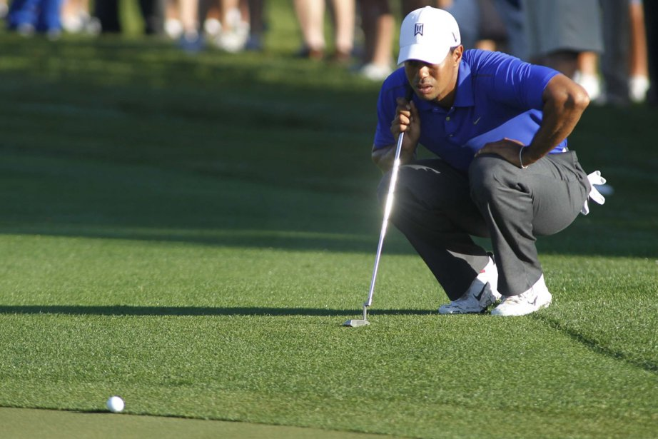 Tiger Woods a réussi trois oiselets à l'aide... (Photo : Joe Skipper, Reuters)