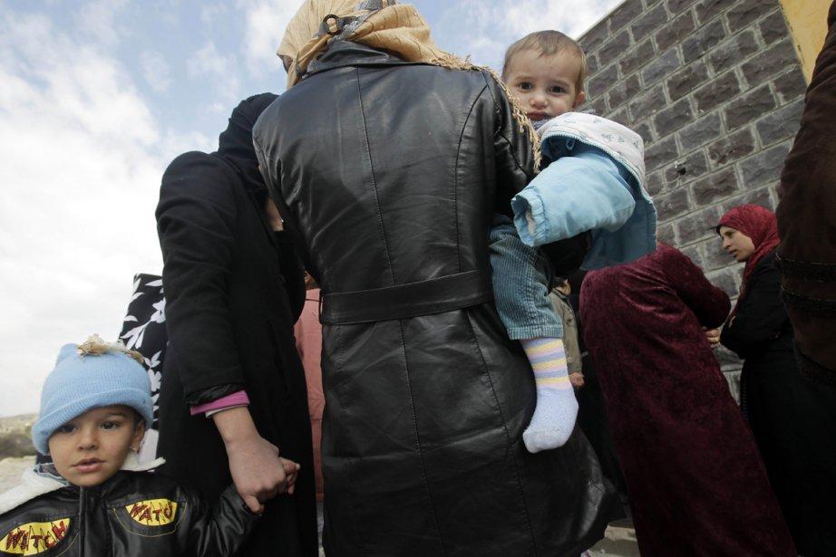 Des réfugiés syriens àWadi Khaled.... (Photo AFP)