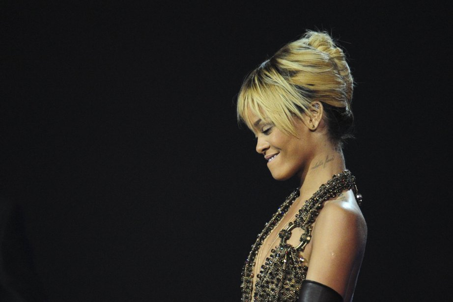 Rihanna aux Brit Awards.... (Photo: Leon Neal, Archives Agence France-Presse)