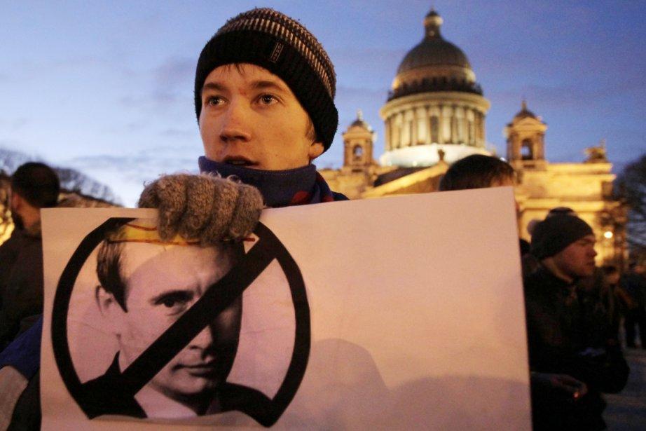 Un opposant au régime Poutine participait, hier, à... (Photo: Dmitry Lovetsky, AP)