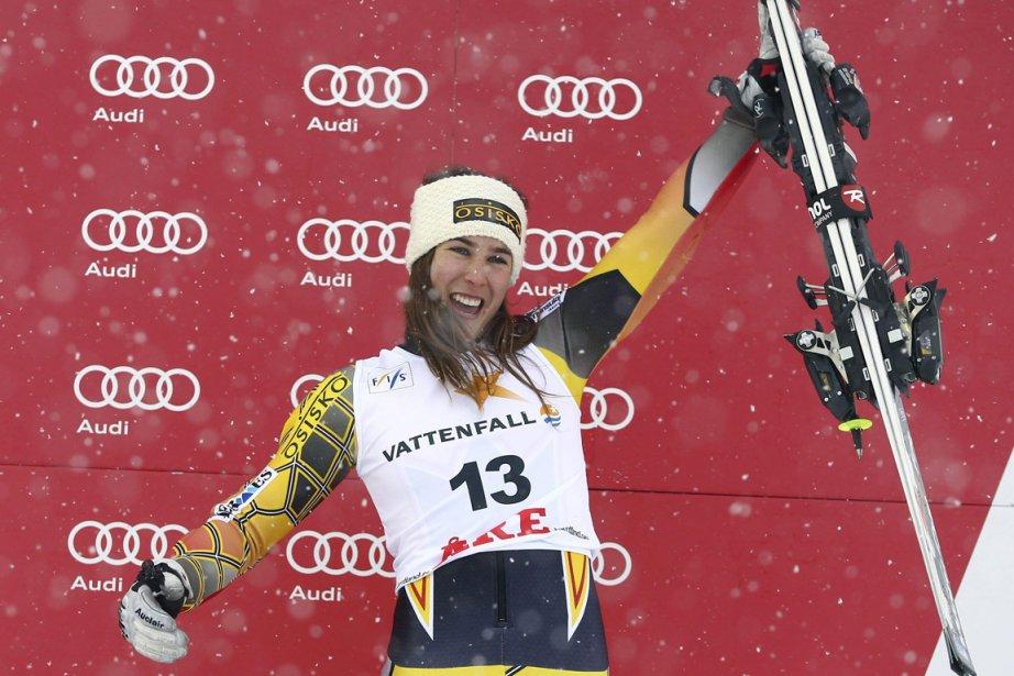 Marie-Michèle Gagnon célèbre sa 3e place sur le... (Photo Alessandra Trovati, AP)