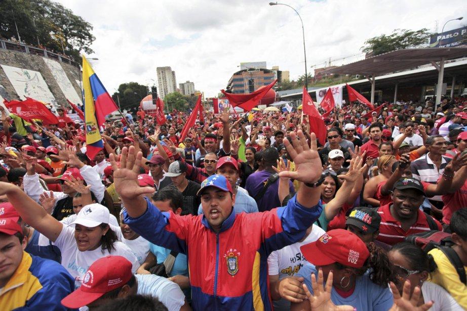À Caracas, la capitale du Venezuela, les participants... (Photo : Fernando Llano, AP)