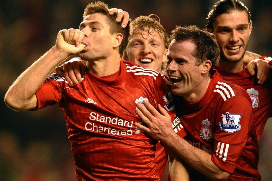 Steven Gerrard (gauche), longtemps absent en raison de... (Photo : Paul Ellis, AFP)