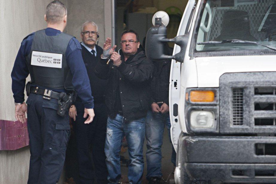 Raynald Desjardins (au centre) est accusé d'avoir comploté... (Photo: François Roy, Archives La Presse)