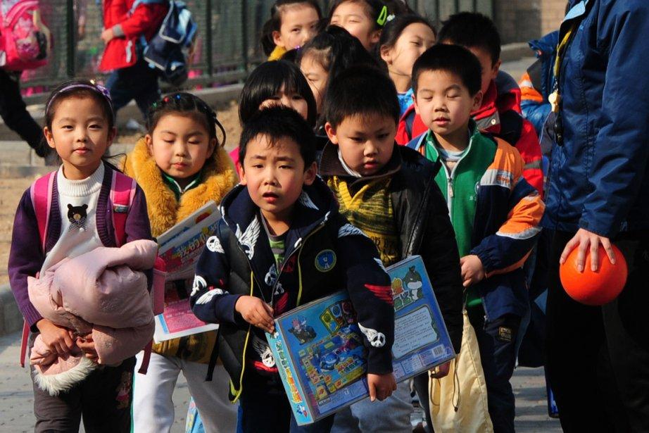 Des enfants à la sortie d'une école primaire,... (Photo Mark Ralston, AFP)