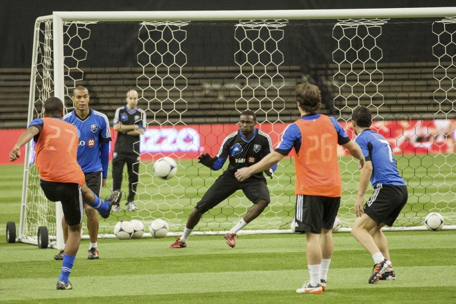 Les joueurs de l'Impact à l'entraînement, hier, au... (Photo Édouard Plante-Fréchette, La Presse)