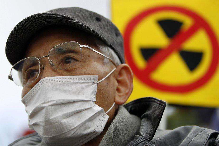Un Japonais prenait part à une manifestation le... (Photo: Reuters)
