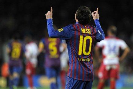L'Argentin Lionel Messi, auteur d'un triplé, est devenu mardi... (Photo: Reuters)