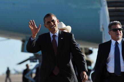 Barack Obama a salué le public à son... (Photo: AFP)