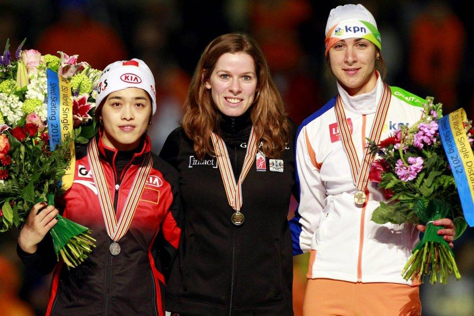 Christine Nesbitt (au centre), Jing Yu (gauche) et... (Photo AFP)