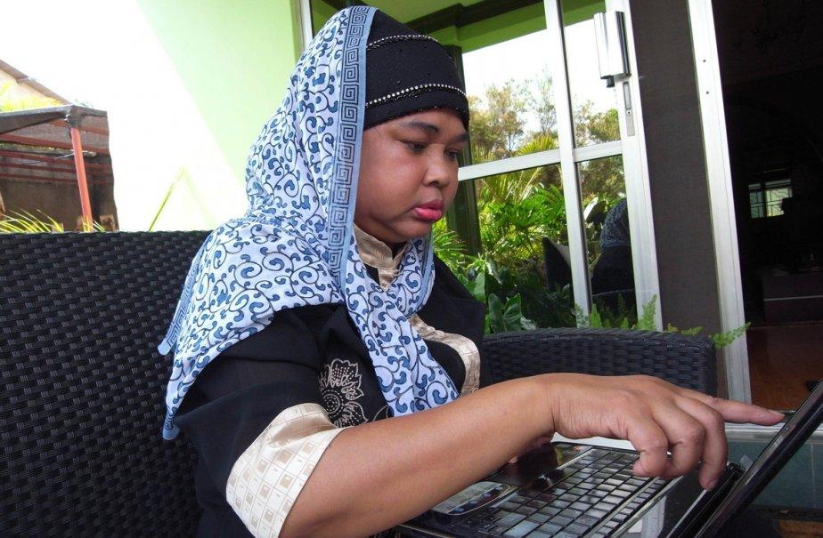 La consulaire de l'Ouganda en Malaisie, Hajah Noraihan,... (Photo: MAX DELANY, AFP)