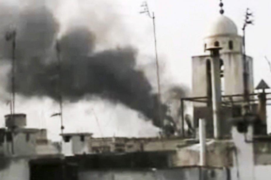 L'armée syrienne bombardait violemment plusieurs quartiers de Homs,... (Image: AP/APTN)