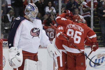 Tomas Holmstrom a marqué deux buts et les Red Wings de Detroit ont... (Photo: AP)