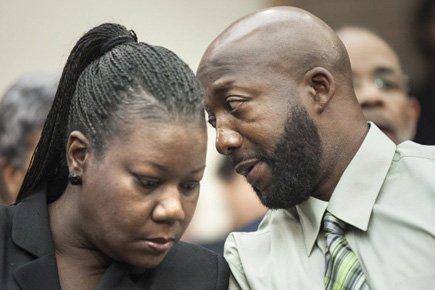 Les parents de Trayvon Martin,Sybrina Fulton et TracyMartin,... (Photo: AFP)