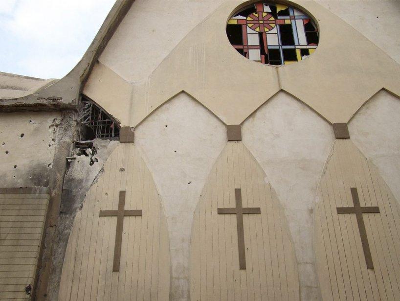 Une église endommagée à Homs.... | 2012-03-31 00:00:00.000